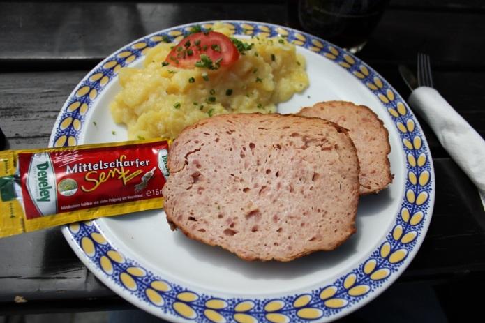 This Leberkäse was eaten at the Weltenburger Klosterbrauerei.  It was served with Kartoffelsalat (potato salad) and mustard.