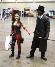 I'm not certain, but I think she's Harley Quinn. Big mallet though.
